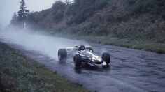 "Dan Gurney in his Eagle at the Nurburgring, heads towards ""Schwedenkreuz"" at the German Grand Prix 1968 Dirt Track Racing, F1 Racing, Drag Racing, Dan Gurney, Formula 1 Car, Full Face Helmets, Vintage Race Car, Indy Cars, Car And Driver"