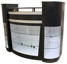 Reception desk featuring built-in retail displays and granite top. Also features four drawers, two of which are locking, and two locking cabinets. CCI Beauty has been selling quality hair salon and spa equipment and furniture since Salon Reception Area, Reception Desk Design, Reception Ideas, Spa Furniture, Reception Furniture, Beauty Salon Equipment, Beauty Salon Decor, Counter Design, Granite Tops