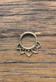Lotus Pierced Septum Ring in Brass | Now available at The Freedom State |
