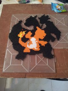 """pixandpins:  """"All three evolutions in one (Charmander, Charmeleon, Charizard). I'd like to see it melted, because I'm curious how the two colors next to each will work out.  """""""