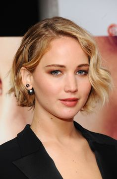 J-Law frames her face with artfully-curled pieces that are never too perfect.   - MarieClaire.com