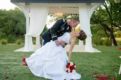 Military wedding bride and groom pose, red accents