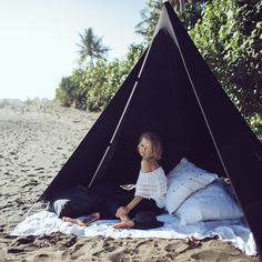 Medium in stock. Please allow 2 weeks on other sizes. We may be able to direct you towards a stockist in your area if you contact us. Original tipi style beach tent designed in Byron Bay Australia. Made individually by hand.Machine washable. Your package comes in a matching bag that is lightweight and easy to carry. More compact than a beach umbrella. They have a low surface area and secure into the sand holding well in windy conditions and they are easy for a single per...