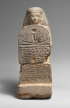 Kneeling statue of Bay [Egyptian].   The completed statuette depicts a kneeling man holding a stela inscribed with a hymn to the sun. item (66.99.94,2009.253) via Heilbrunn Timeline of Art History | The Metropolitan Museum of Art