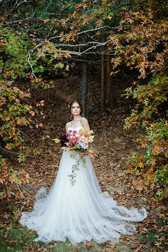 Fall inspired bridal look with an off white soft flowy dress, red head bride and hues of deep red and orange! Outdoor Wedding Inspiration, Wedding Photography Inspiration, Wedding Ideas, Floral Wedding, Wedding Bouquets, Wedding Dresses, Woodland Theme Wedding, Winter Bouquet, Bridal Shoot