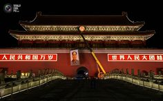 The old portrait of China's late Chairman Mao Zedong is removed from Tiananmen Gate in Beijing