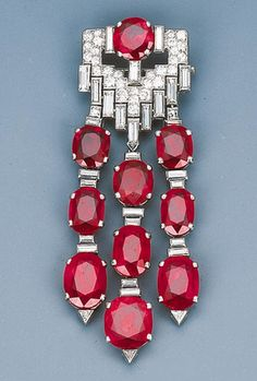 Van Cleef & Arpels ~ Art Deco Ruby and Diamond Pendant Brooch, Circa 1930, with French assay marks, 7.5 cm long Signed Van Cleef & Arpels, Paris, No. 32702