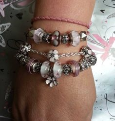 Finding I'm attracted to the pink cherry blossom charms. Love my Pandora bracelet.