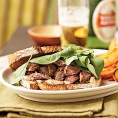 Mayonnaise, Worcestershire, and whole-grain mustard combine for a tangy, slightly smoky sandwich spread. Arugula is a peppery salad green...