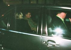 Princess Diana leaves with Dodi escorted by bodyguard Trevor Rees-Jones, as they left the rear of the Ritz Hotel at he start of their final, fateful journey.