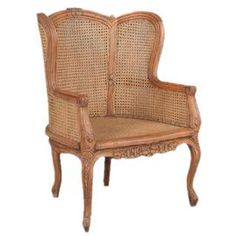 """Offer guests an extra seat with this eye-catching essential, a welcome addition to your well-appointed home. Product: Accent chairConstruction Material: Mahogany and caneColor: WalnutFeatures: Hand-carved moulding exhibits foliate and volute motifsSleek cabriole legsWill enhance any decorDimensions: 42"""" H x 29"""" W x 30"""" D"""