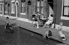 Oldham: Things look cleaner in this street in 1969, but with children playing in the street together, it shows a lifestyle rarely seen today