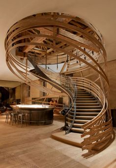 Wooden strips coil around staircase Iam Architect