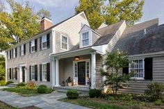 Renovated colonial with side door to mud room.