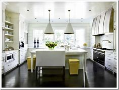 The banquette is a more interesting choice than yet another yellow stool, and looks SO stylish. I'm also a big fan of the pendants with a hint of yellow inside, and the fabulous black candleholders in the background.  5 Steps to a Kitchen you will Love! | Maria Killam