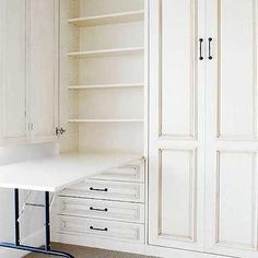 closets - hidden table, concealed table, drop down table, antique white cabinets, Closet features antique white cabinets accented with oil-rubbed