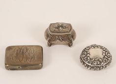 Sterling silver pill box, miniature casket, and repousse locket.