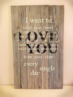 I want to love you sign made using repurposed pallet or barn wood. Gray stained background allowing wood grain to show.