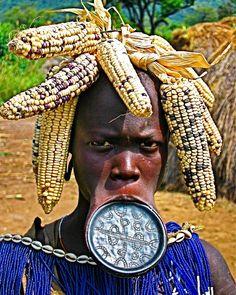 Ethiopia - best trip Eva!  #mursi#tribeswomen#tribal#women #lipplate#stretch#corn#maize#food #headdress#beads#different#omo #valley#desert#landscape#travel #instapic#beardedgay#instagay#gay#scruff#fitfam#roamingon @vodafoneau by james.shilton