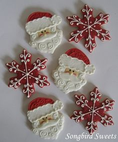 adorable santa and snowflake cookies - imagine these added to the cardinal cookies on a black tray...