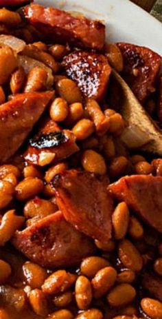 Kielbasa and Honey Barbecue Baked Beans - cooked low and slow yields a dish packed with flavor that& perfect for cookouts or an economical weeknight meal. Baked Bean Recipes, Pork Recipes, Cooking Recipes, Barbecue Recipes, Grilling Recipes, Beans Recipes, Barbecue Sauce, Pork And Beans Recipe, Recipies