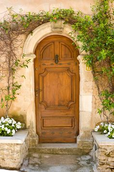 The stone surrounding the front door is original, with the date 1699 carved into the keystone. - Country French ® / Photo: Gordon Beall / Design: Alix Rico