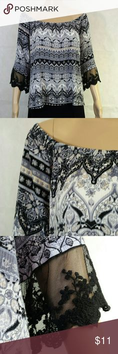 Peasant-Style Ladies Top by ALLOY -Elastic gathered neckline, can easily be worn off the shoulder.  -Sleeves trimmed with a wide black lace.  -Interesting horizontal printed pattern in colors of black, soft gray, pale pink, very light tan, and ivory.  -Fabric is 100% stretch Rayon -Measures approximately 24 inches across from underarm to underarm.  -Approximately 24 inches long from neck seam to the hem edge. -BUNDLE BUNDLE BUNDLE and SAVE.  -Reasonable offers considered. ALLOY Tops Blouses