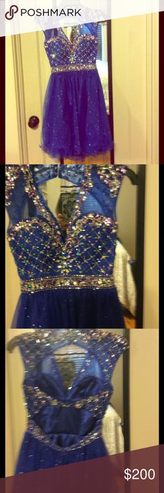 In perfect condition prom/homecoming dress Worn for 1hr blue dress with gorgeous bead and crystal dress Double opening back sparkle skirt Hannah S Dresses Prom