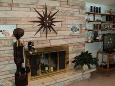 I love this stacked stone fireplace because it brings back some good memories... mid century fireplace with starburst clock