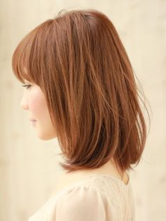 Mid-length bob with straight bangs.