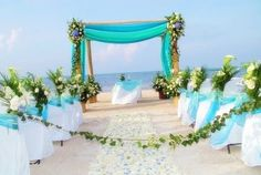Above is a white and blue beach wedding decoration. Photo is the ...