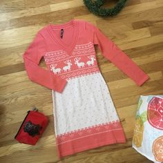 """Cozy Hour NWOT It's cozy hour in this curve hugging long sleeve Boston Style Sweater Dress.  Knit patterns of deer, diamonds, and hearts. This V-neck unlined pullover flirty touch assures you will be the hit of any cozy hour.  💖. (Sold as orange and white but this is more of a peach and white color to my eyes 👀) 100% acrylic, regular style sweater stretch in fabric. Shoulder to hem approx 35 1/2"""", underarm to underarm 14 1/2"""". White Mark Dresses Long Sleeve"""
