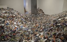 Erik Kessels has created this incredible room of pictures after downloading and printing out every picture uploaded to Flickr in 24 hours.
