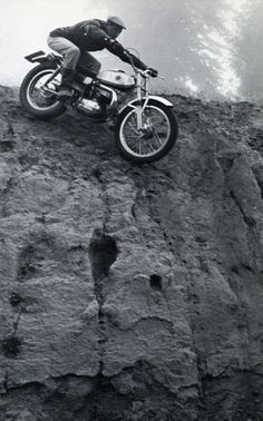 Sammy Miller - This photo has always fascinated me. Appears to be such an extreme drop, but you know that on a vintage Bultaco it really can't be all that extreme. Always wondered what is out of frame, that he is about to land on.