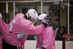 """Goalie Love"" - Chris Wolfinger celebrates a point with goaltender Alex Corbin last October as the SDSU hockey team donned pink jerseys that were then auctioned off to support breast cancer research."