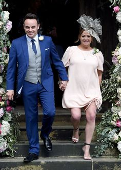 Biggest fan: Ant beamed as he left the church with his wife Lisa Armstrong who looked stu...
