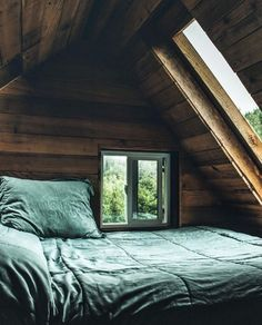 A Northern Cabin | attic bedroom | nook | skylights | views | small bedrooms | cozy | relax | wood panels