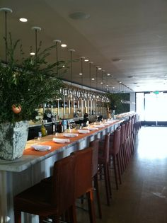 Another View Of The Communal Table & Tasting Bar At Fig & Olive Restaurant In West Hollywood, CA.