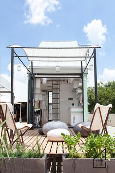 The POD-idladla: a bright and modern 185 sq ft home from South Africa with a roomy covered deck.