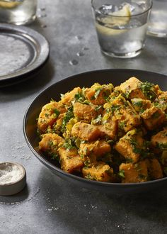 Vegan Curried Sweet Potato With Herbs - This curried vegan sweet potato dish is sooo delicious and super easy. A fantastic easy healthy dinner for the whole family.