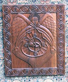 Annunciation, Mahogany. Original design and woodcarving by Leslie Barton Mulledy. 1998