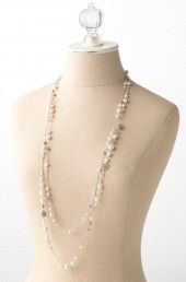 Madeline Pearl Necklace by Stella & Dot. Photo of mixed pearl, bead, & stone necklace layered long on bust.