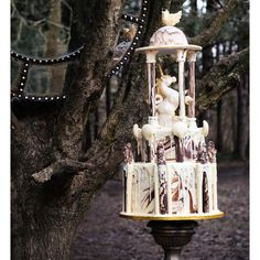 If you really want to make a statement at your wedding, cakes like this one by Choccywoccydoodah are the way to do so. The marbled effect that has been created by white, milk and dark chocolate is such a skill that has an incredible finished look. It's also another way to incorporate more unicorn wedding ideas into your big day, because who doesn't love mythical creatures with magical horns?