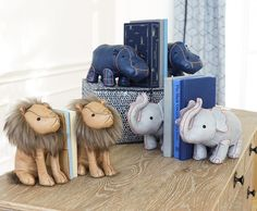 Renowned fashion designer Monique Lhuillier invites whimsy to your children's room with these vegan leather animal bookends.