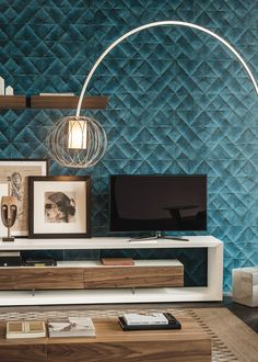 Boxer is a TV cabinet with white or graphite embossed lacquered frame designed by Paolo Cattelan. It is a beautiful and modern piece of furniture for your living room.