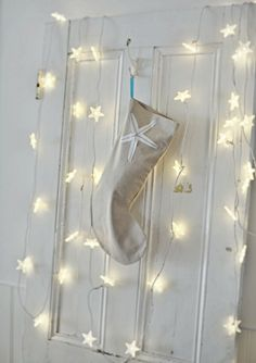Beach Cottage Christmas All is Calm, All is White - add a little sparkle to any room with lights and a stocking