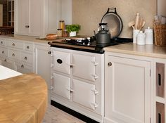 Teddy Edwards Goodwood range housing aga in chimney breast