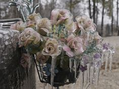 Cemetery flowers after the ice storm -- Photo credit: photopeter159