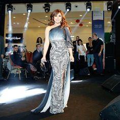 "@najwakaram looked Fabulous in this Costumized Grey-White-Black mixed Gown by @nicolasjebranworld ""Collection piece"" while performing yesterday night at Dragon Mart Dubai 2017 @dragonmart #Najwakaramfashion™ #NajwaKaramFashion #NKF #NKF™ #NajwaKaram  #nicolasjebran  #hautecouture #Australia  #Najwa  #instagood #fashionista #instagram #instacollage dragonmart #نجوى_كرم #fashiongram #celebrity #arab #smile #fashionstyle #fashionaddict #photooftheday #2017 #Dubai"
