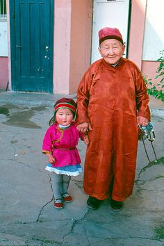 Mongolian elder and granddaughter